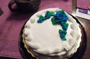 If we must have flowers, at least these are blue roses, which exist only in the imagination.   And on cake.